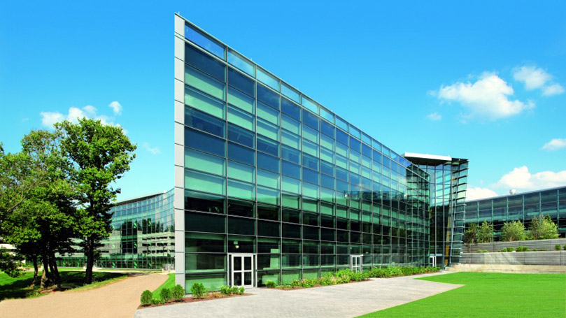 modern office exterior with Schuco aluminium curtain walls with mullions and transoms and reflective glass for residential, public and hospitality buildings