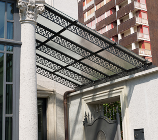 Iron and Glass Canopies with Decorative Inserts for Office Building Entrances