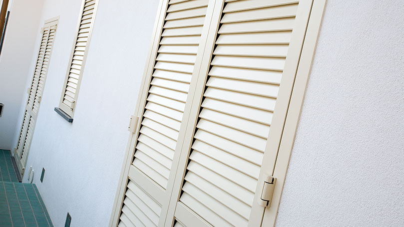 White Armoured Shutters with Anti-Dard System and Wall Fastening Frame