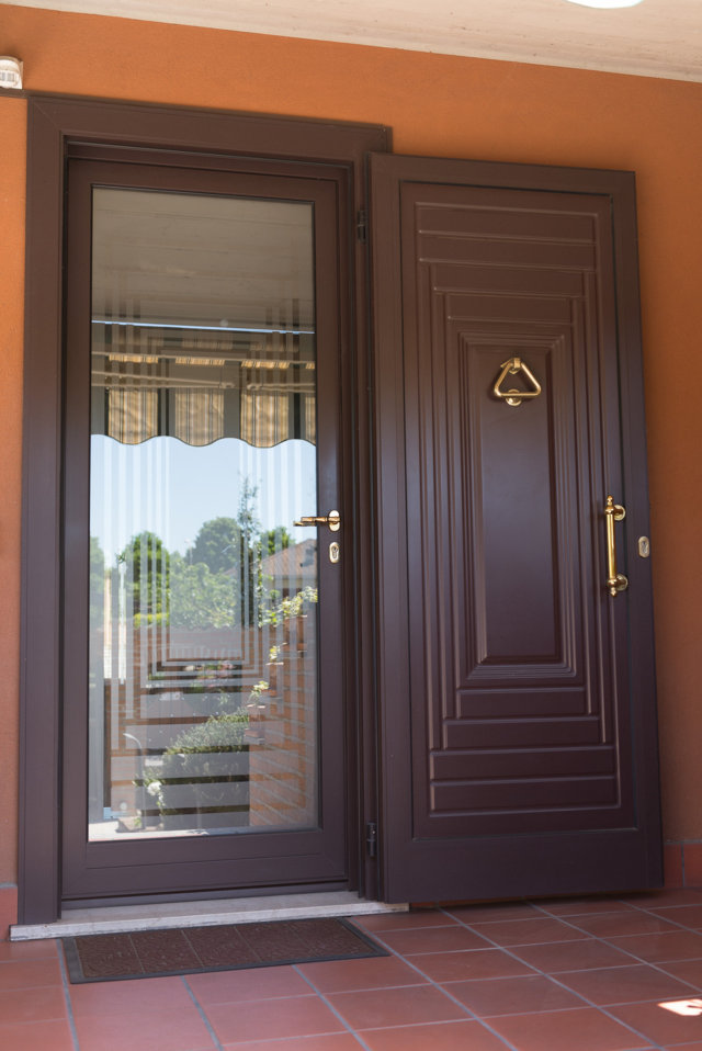 aluminium entrance door with double security door manufactured and installed by Aluser