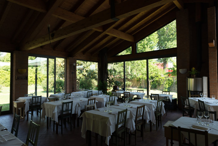 interior of the corner restaurant in vittuone where you can see the schuco sliding doors and windows