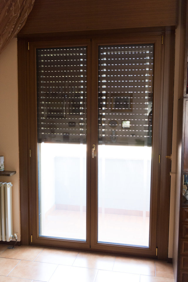 installation of aluminum windows and doors in Pavia interior wood color made by Aluser