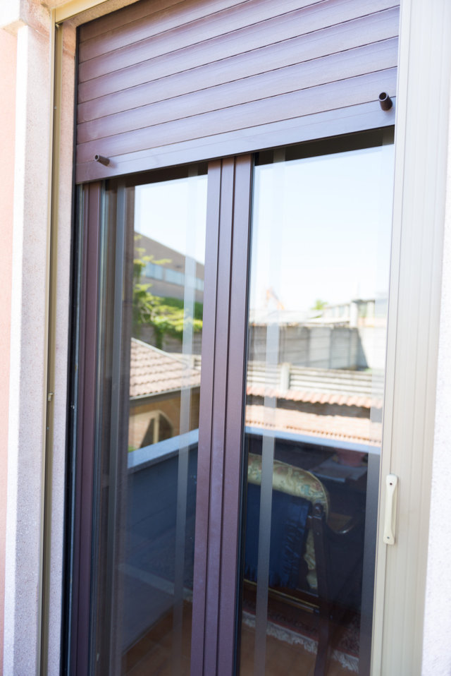 installation of aluminium windows and doors in Pavia two-tone made by Aluser