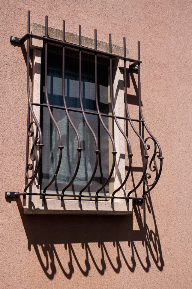 iron security grilles installed by Aluser in Pavia