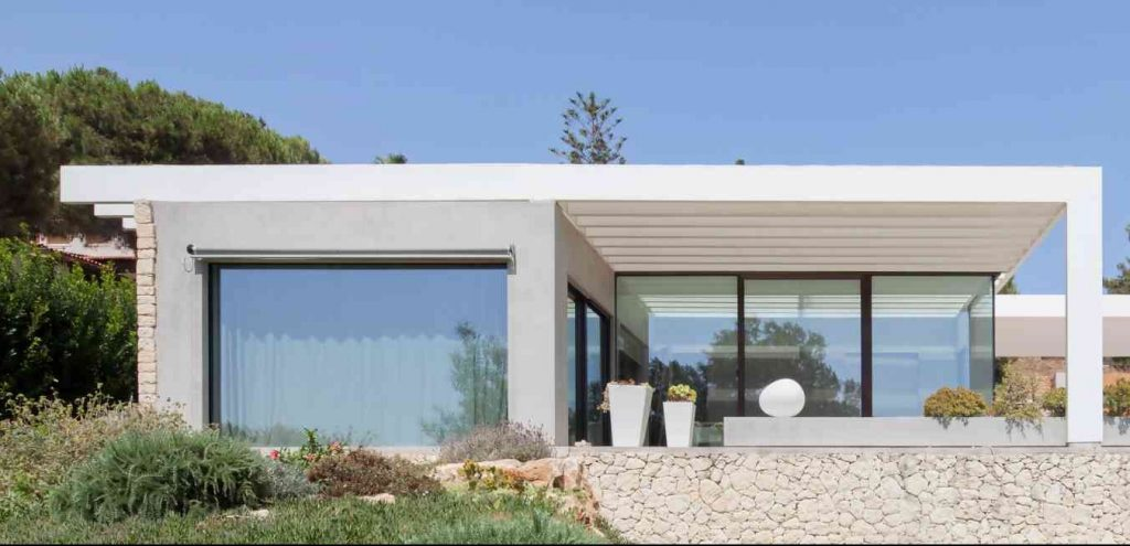 schuco windows and doors for a beach house with aluminum windows with minimum sections to maximize internal brightness