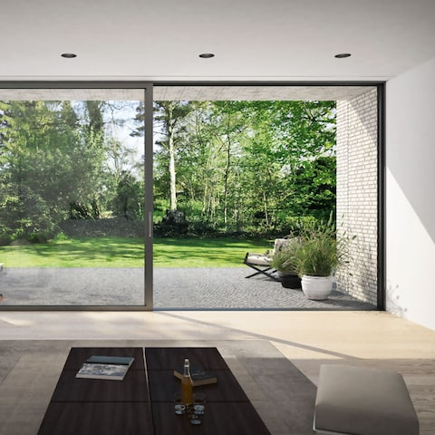 schuco panoramic sliding door installed in a modern house with garden view